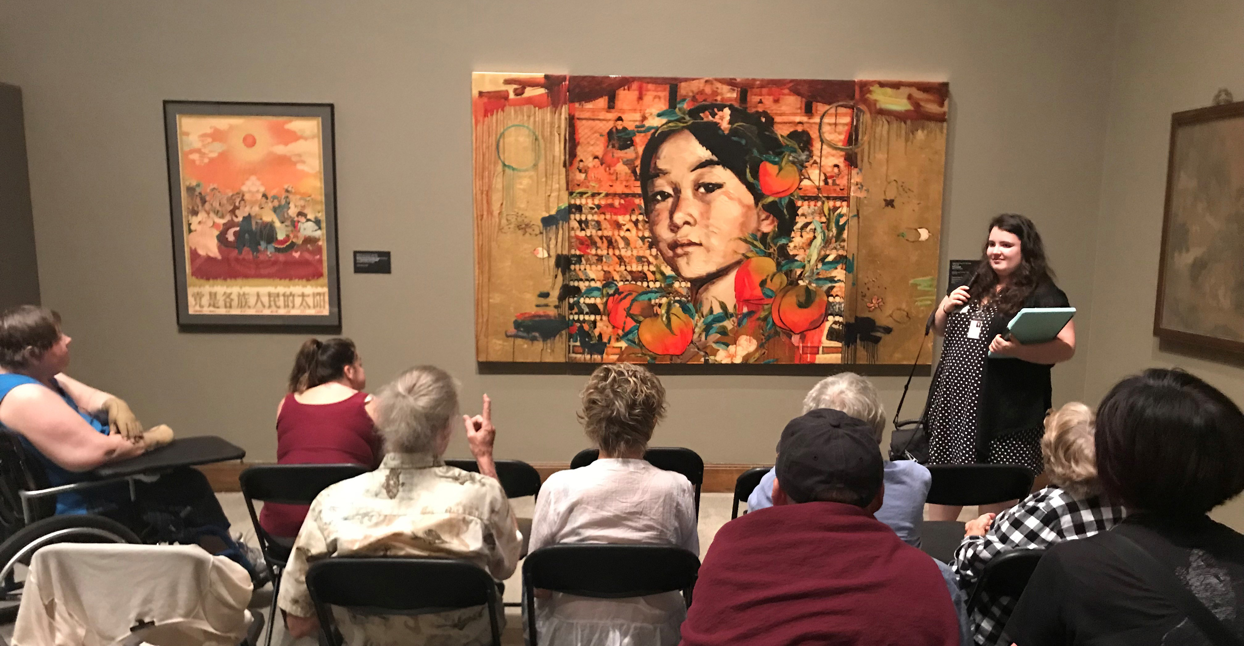 Figure 3. Facilitated by a museum docent, adult viewers discuss a 2011 mixed-media triptych print,All the Ancestors, by Chinese-American Hung Liu from the University of Oregon Jordan Schnitzer Museum of Art collection.