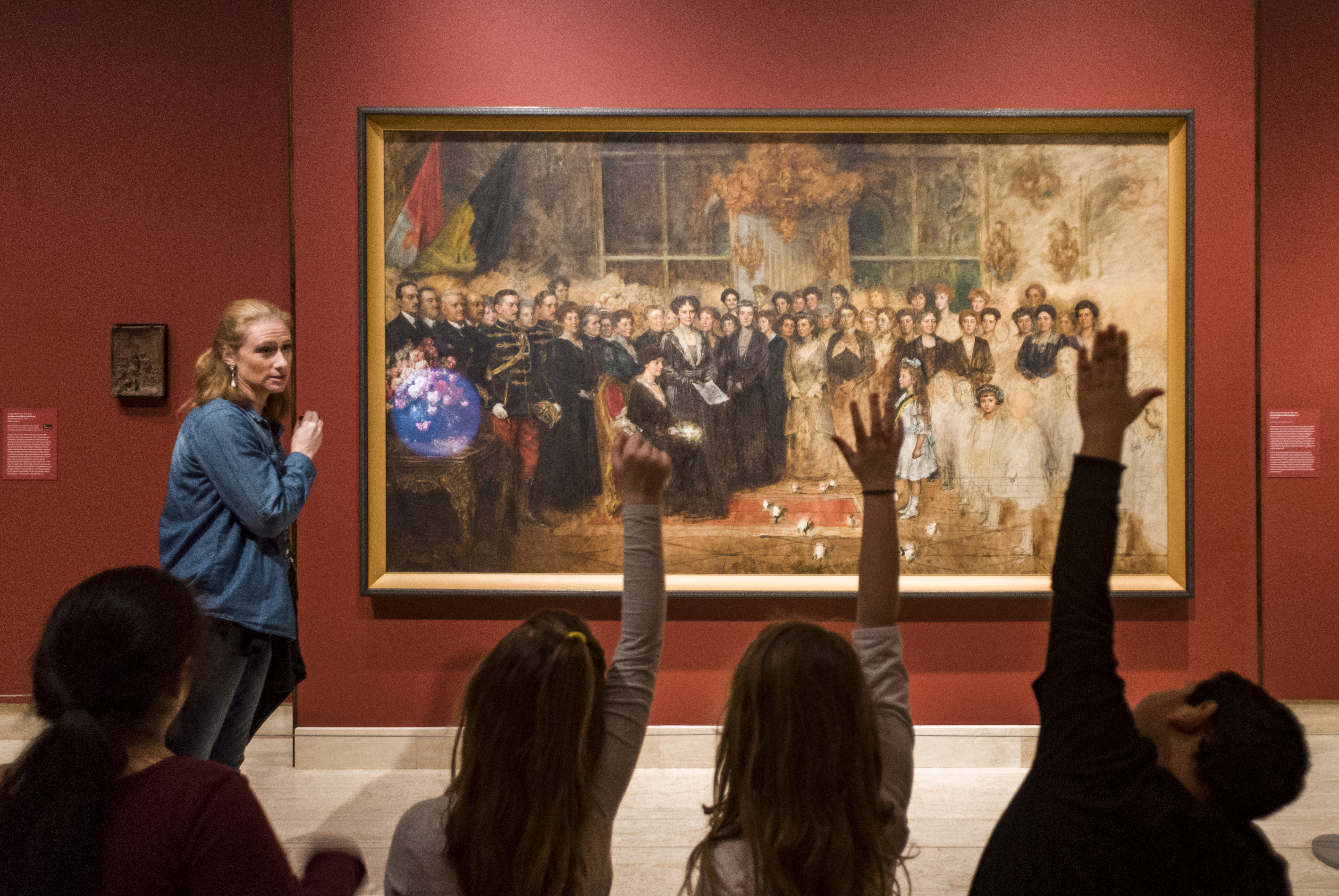 Figure 1. At the galleries of the University of Oregon Jordan Schnitzer Museum of Art, a teacher uses the Visual Teaching Strategies method with students to think critically aboutThe Last Audience of the Hapsburgs, a 1918 oil painting by Hungarian artist Artur von Ferraris.